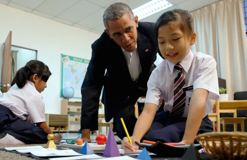Obama greets students during a tour of the Dignity for Children Foundation in Kuala Lumpur